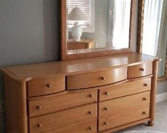 Solid wood bedroom set: dresser with mirror, two nightstands, queen bed. Manufactured by Webb of Virginia