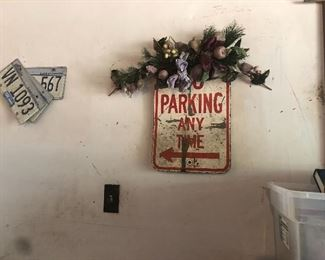 no parking sign, lots of old license plates