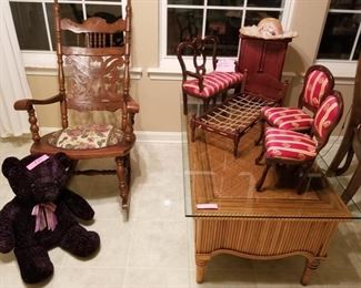 Beautiful old rocker, rattan coffee table with class top, large, medium and small doll furniture.