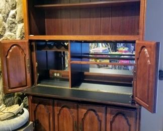 Beautiful two piece bar with lights on two levels, outlet and hook up for cable TV.  Wine glass holder, wine bottle holder and lot's of storage in bottom.