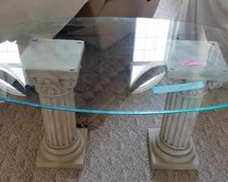 Oval glass table with columns