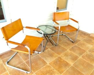 TWO Leather Cantilever Chairs - (24W  20D  29-1/2H at back)