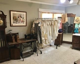 "Grandfather clock, trestle sewing machine, folding clothing rack, linens, ""whites"", christening garments, accessories"