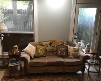 "sweet caramel sofa, cool embroidered pillows, mid-century ""bamboo"" oak side tables, dogs...."