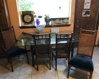 """glass top """"bamboo"""" with four matching caned chairs"""