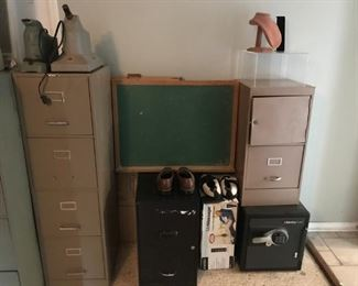 Chalkboard, file cabinets, small safe, men's shoes