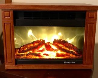 Heat Surge mini electric fireplace heater (this is a small personal size unit)