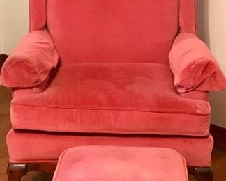 Pink upholstered wing back chair and ottoman