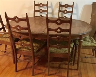 Mid-Century Stanley Furniture oval dining table with leaf and 6 ladder-back chairs