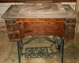 Antique Minnesota A treadle sewing machine in original cabinet