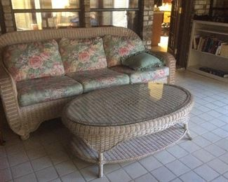 Wicker couch, coffee table, chair and ottoman