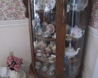 wonderful curved front cabinet handpainted glassware