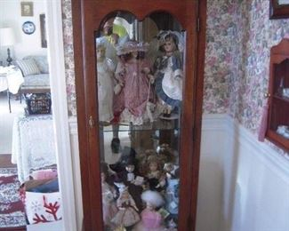 Mahogany curio cabinet , part of collection dolls
