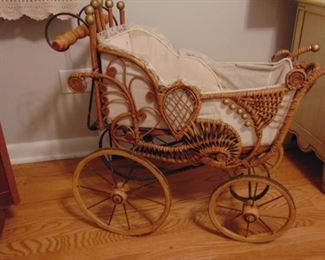 Small, wicker doll buggy