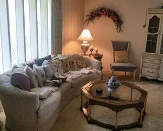 sofa is not for sale ( it belongs to the family) cute pillows and linens, coffee table