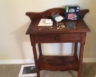Antique table with spoiled legs