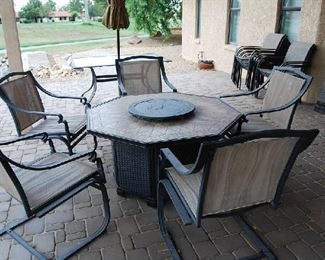 Patio table and chairs with built in fire pit