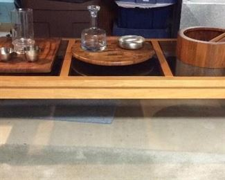 Mid century coffee table and teak   dansk serving pieces