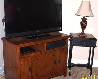 Flat screen TV, TV stand and lamp table