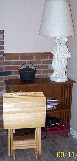 Small book shelf, figural lamp, cast iron pot and wood TV trays.