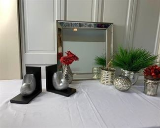Mirror with silver decor and seashell bookends             https://ctbids.com/#!/description/share/237192