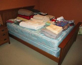 Mission style bed with bedding and linens