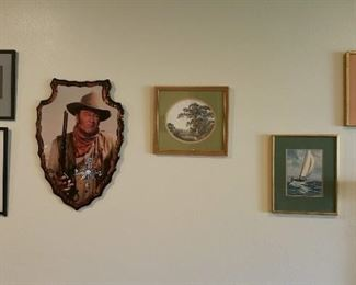 various etchings and a completely out of place John Wayne clock.  Nevermind, The Duke goes wherever he wants to....