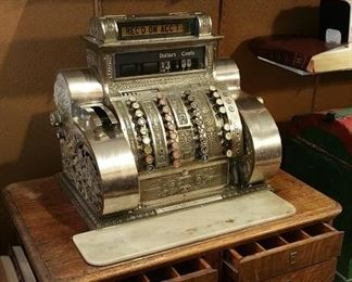 WOW and WOW again!  Antique National Cash Register on original oak drawer base.  Mostly works but I think it's mostly the operator who has no clue how to use it!