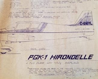 Original plans for the PGK-1 Hirondelle Plane. Th engine is mounted on the front portion of the partially built plane.