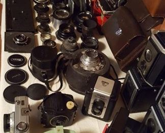 Vintage camera collection including Girl Scout camera