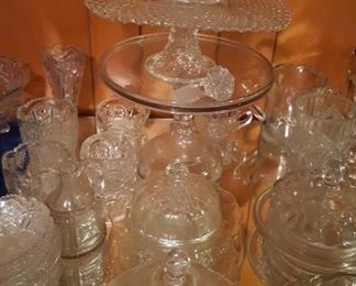 Pressed glass pitcher and cake stands
