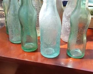 Rare straight sided Coke bottles and 1929 pinched peanut Pepsi bottles