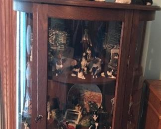 Bow front china cabinet with large collection of Border Collies.