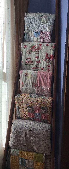 Handmade quilts and repurpose of barn loft ladder