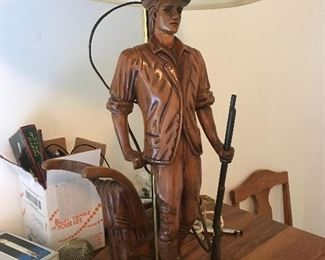 Hand carved wood lamp with metal gun .