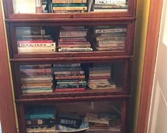 Lawyers bookcase with large assortment of books on dogs