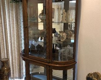 curved glass curio cabinet  and lots of great things to fill it with at this one :))