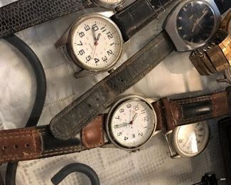 lots of old watches -in varying states of need