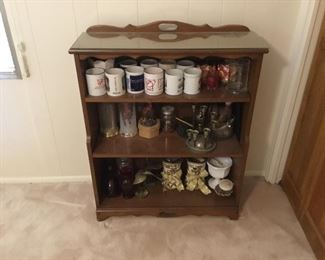 Small bookcase with cups & decor items