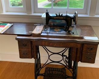 VINTAGE SEWING MACHINE WITH ORIGINAL MANUAL AND ALL WORKING PARTS.  GOOD CONDITION $100.00