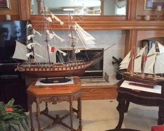 Large model of U.S.S. Constitution with a smaller three masted schooner.