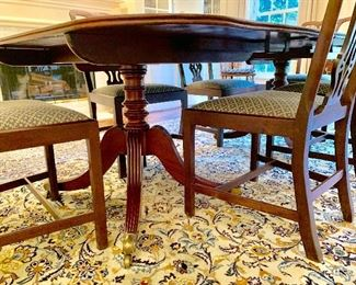 """Period mahogany double pedestal banquet table from the Estate of General William Terry with 6 English Chippendale dining chairs; rug is approx 12'4"""" by 9'6"""" Keshan"""