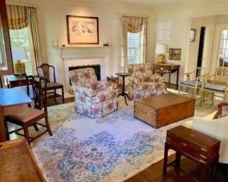 Living room full of antiques with ivory Kerman rug