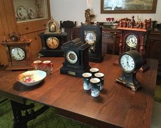 A sample of the large collection of clocks. The center clock was a wedding gift from the clergy of St. Peter's Church in Wales to Mr. and Mrs. Jones.  Also William Gilbert curfew clock. Seth Thomas. Sessions.