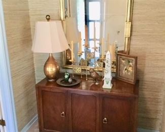 THE SIDE CABINET WITH TWO DOORS, AND BEHIND THE LEFT DOOR IS THREE DRAWERS, STORAGE BEHIND OTHER DOOR AND THE MIDDLE  PANEL----GREAT CONDITION   THE MIRROR IS SO GREAT AS IS THE LAMP