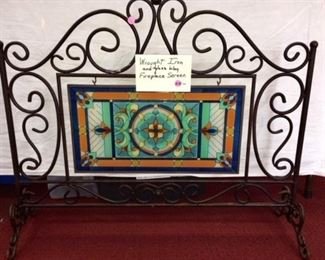 Wrought iron fireplace screen with glass inset
