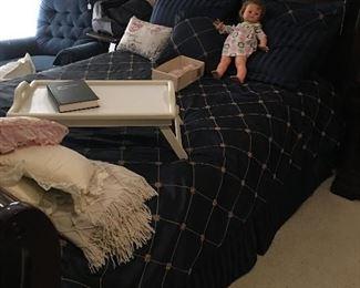 Sleigh bed, blue recliner