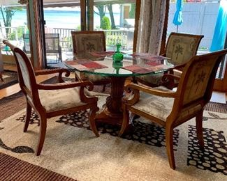 Glass top, heavily carved dining room table