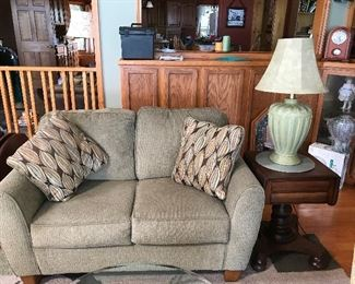 Tan Loveseat with pillows