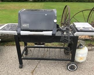 . . . a nice Weber grill -- we'll throw in the cover